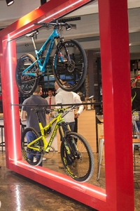 Large displays featuring suspended bicycles enhance the store's modern look.